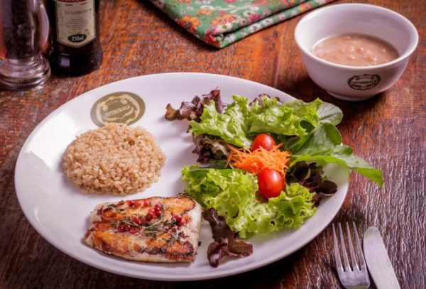 Fish filet with thyme sauce and rose pepper. Accompanied with multigrain rice, pinto beans and mixed salad