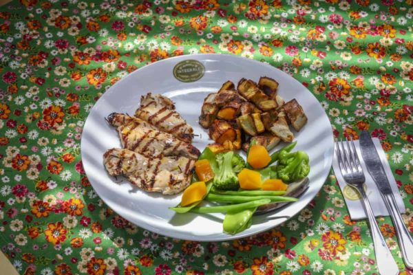 Chicken breast filet with baked roots and steamed vegetables