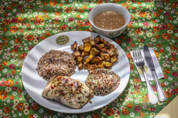 Grilled local fish filet Accompanied with multigrain rice, pinto beans, baked roots and quinoa tabule