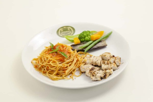 Whole grain spaghetti with tomato sauce and basil, grilled organic chicken breast filet and steamed vegetables